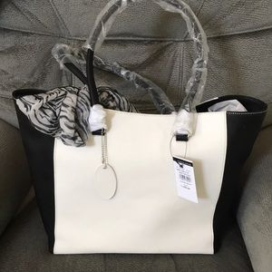 Chic black and white Wilsons Leather Tote